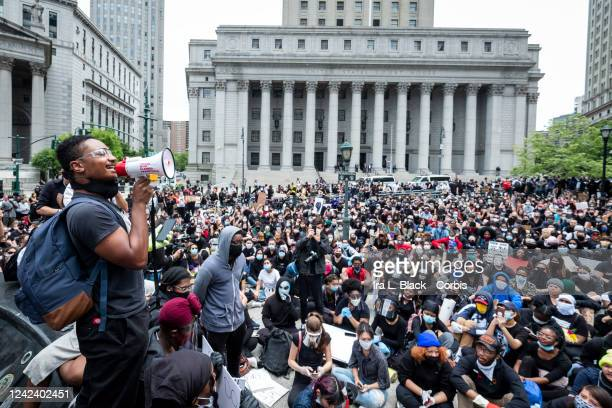 A massive group of protesters sit on the ground at Foley Square in a show of peaceful protest while they listen to a speaker Protesters took to the...