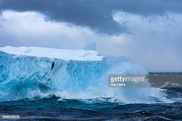 Massive Iceberg floating in Antarctica in a storm