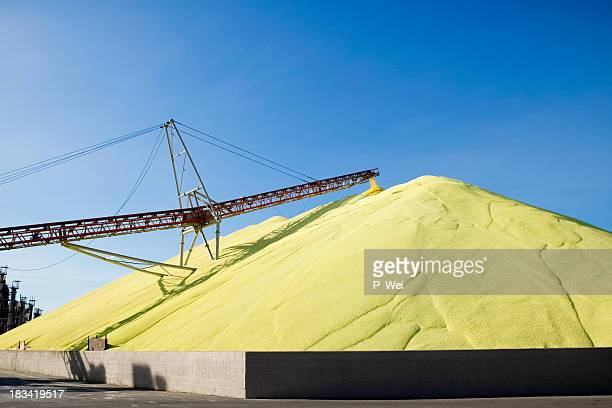 Massive mound of industrial sulfur at worksite
