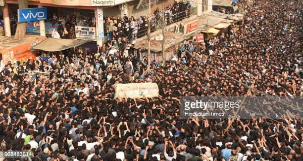 A massive procession is seen commemorating the martyrdom of Hazrat Imam Ali on 21st day of Ramzan in the old city area on June 6 2018 in Lucknow...