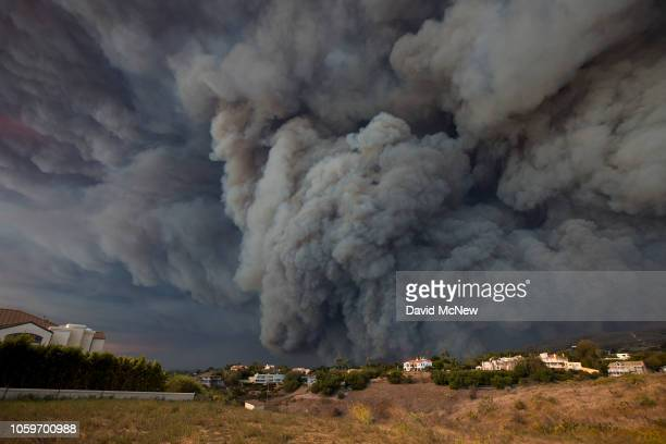 A massive smoke plume powered by strong winds rises above the the Woolsey Fire on November 9 2018 in Malibu California About 75000 homes have been...