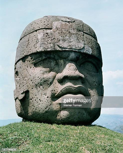 Massive stone head possibly representing a planetary deity oran individual ruler possibly deified and worshipped as ancestor Mexico Olmec