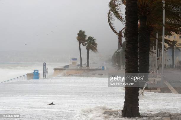 Massive waves break against the shore on the landmark Promenade des Anglais avenue in the French riviera city of Nice southeastern France on December...