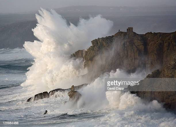 massive waves breaking on headland, cornwall, england - breaking wave stock pictures, royalty-free photos & images