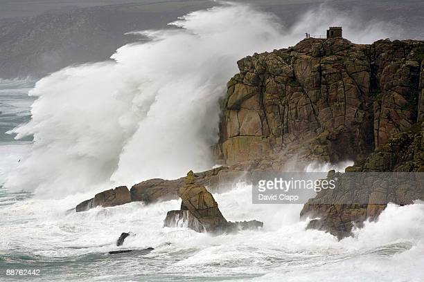 massive waves breaking on headland, cornwall, england - eroded stock pictures, royalty-free photos & images