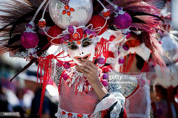 Masskara Festival performers wearing outstanding costumes and masks. MassKara Festival, one of the biggest and most colorful Filipino festivals, is...