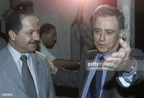 Massoud Barzani head of the Kurdistan Democratic Party is escorted by Syrian Vice President Abdel Halim Khaddam after their meeting in Damascus late...