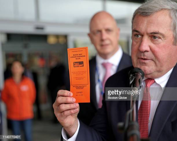 Massport Director of Aviation Ed Freni holds one of the new orange tickets with Massport acting CEO John Pranckevicius standing in the background as...