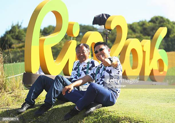 Massy Kuramoto and Shingo Katayama of Japan watch the play from the 16th hole during the second round of the golf on Day 7 of the Rio 2016 Olympic...