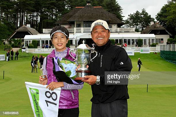 Massy Kuramoto of Japan and his wife Margie pose with the trophy after the final round of the Van Lanschot Senior Open played at Royal Haagsche Golf...