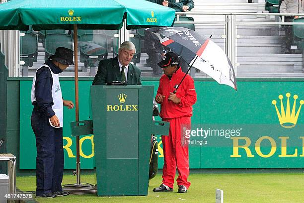 Massy Kuramoto of Japan checks in with the Starter Ivor Robson on the 1st hole during the second round of the Senior Open Championship played at The...