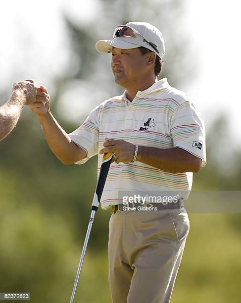 Massy Kuramoto of Japan gets knuckles from his caddie at the 18th hole during the second round of the Champions Tour JELDWEN Tradition at the...
