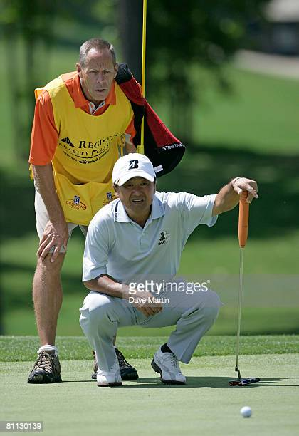 Massy Kuramoto of Japan lines up his putt on the 13th green during round two of the Regions Charity Classic at the Ross Bridge Golf Resort on May 17...