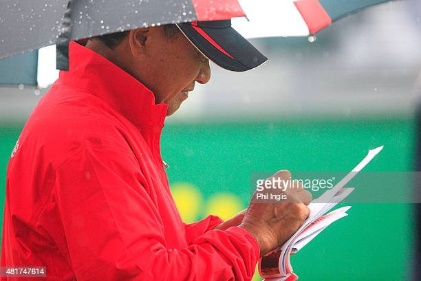 Massy Kuramoto of Japan marks his card on the 1st hole during the second round of the Senior Open Championship played at The Old Course Sunningdale...