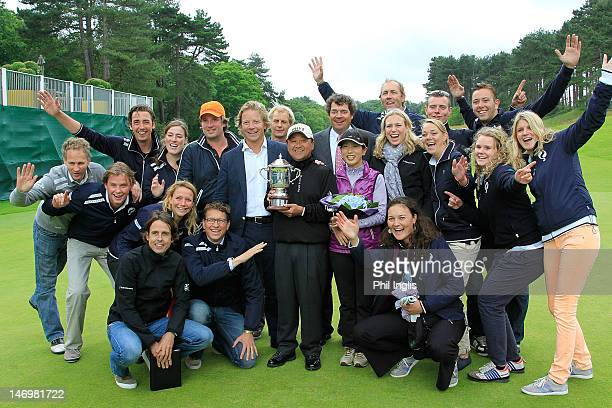 Massy Kuramoto of Japan poses with the administration team after the final round of the Van Lanschot Senior Open played at Royal Haagsche Golf and...