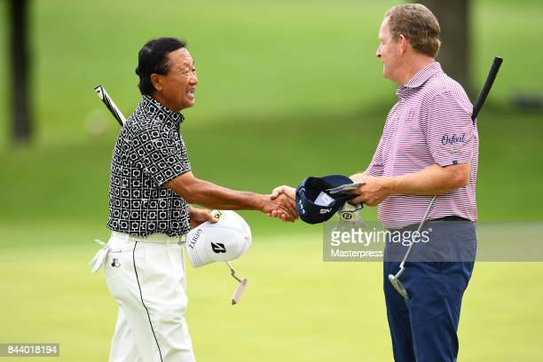 Massy Kuramoto of Japan shake hands after the first round of the Japan Airlines Championship at Narita Golf ClubAccordia Golf on September 8 2017 in...