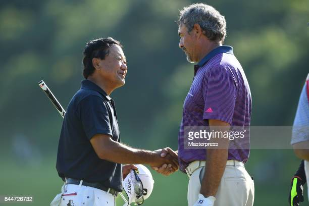 Massy Kuramoto of Japan shake hands after the second round of the Japan Airlines Championship at Narita Golf ClubAccordia Golf on September 9 2017 in...