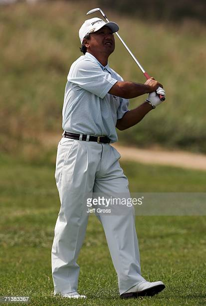 Massy Kuramoto of Japan watches after hitting his second shot on the eleventh hole during the first round of the US Senior Open at the Prairie Dunes...