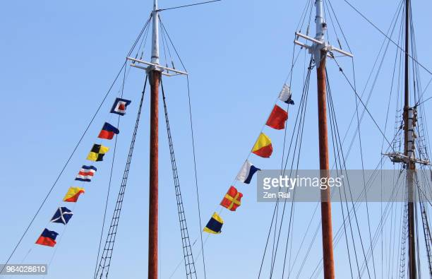 mast riggings and flags on blunose ii in lunenburg, nova scotia - flag of nova scotia stock pictures, royalty-free photos & images