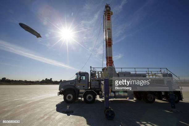 A mast truck stands as the Goodyear Tire Rubber Co Wingfoot Two blimp arrives at the company's airship base in Carson California US on Friday Dec 15...