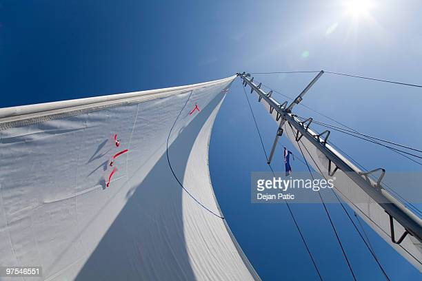 Mast with sail full of wind