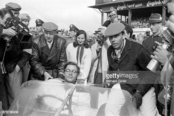 Masten Gregory Lloyd 'Lucky' Casner Maserati Birdcage Tipo 61 1000 Km of Nürburgring Nurburgring 06 August 1961 A victorious Masten Gregory with...
