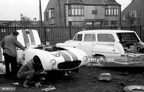 Masten Gregory's Ferrari 375MM and a US Estate Car in the pits paddock area at Aintree England 1954