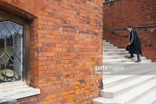 A master at Harrow School climbs steps to one of the many educational buildings Harrow School is an English independent school for boys situated in...