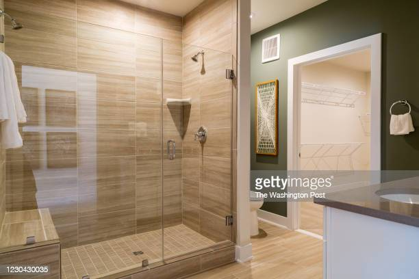 Master Bath showing dual Shower Heads and Walk In Closet in the Brooklyn Model Unit 101 at Tower Oaks on December 17, 2020 in Rockville Maryland.
