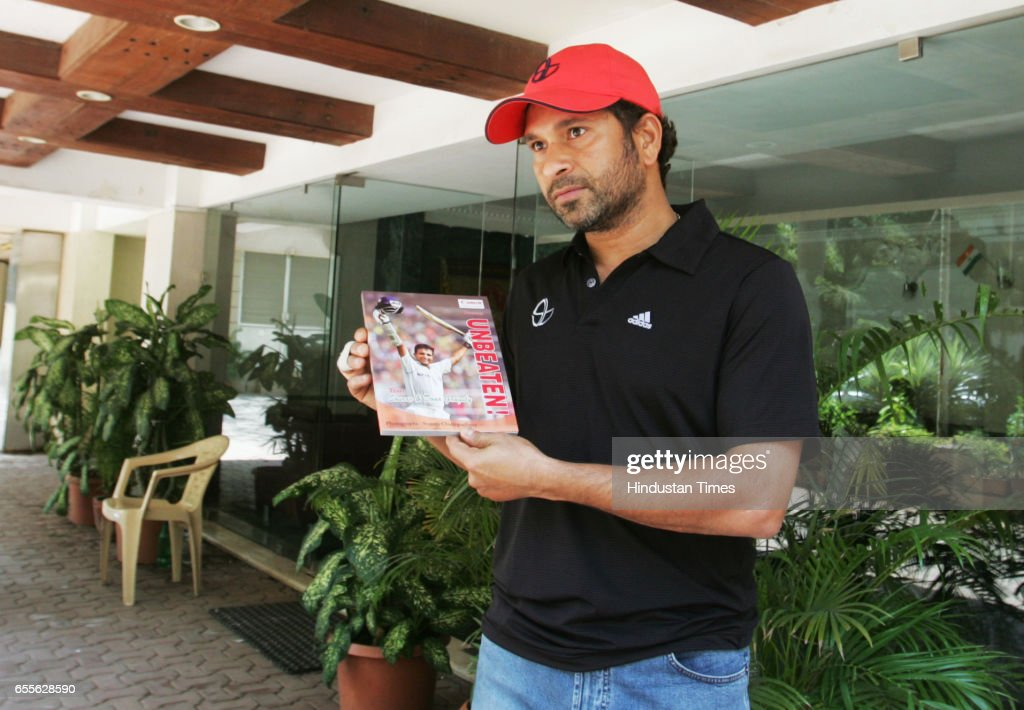 Master Blaster SachinTendulkar releasing the Photo book on Indian former Cricketer Sourav Ganguly the 'Unbeaten !' in front of the building where he stays at Bandra . The book authored by ace sports photojournalist Suman Chattopadhyay a Kolkata based photographer.
