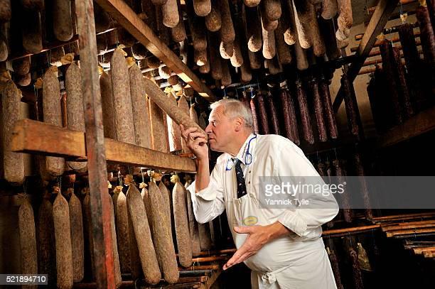 Master butcher Thomas Koch checks the maturing of his 'Ahle Wurst' sausages