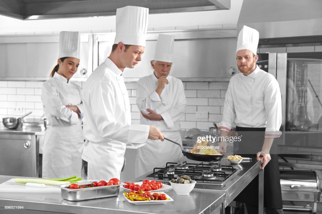 Master Chef Cooking Oyster In Framing Pan Stock Photo