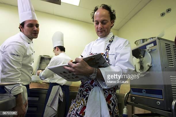 Master Chef Moreno Cedroni of the La Madonnina del Pescatore of Senigallia restaurant signs his latest book Sushi and Susci for a chef as he attends...