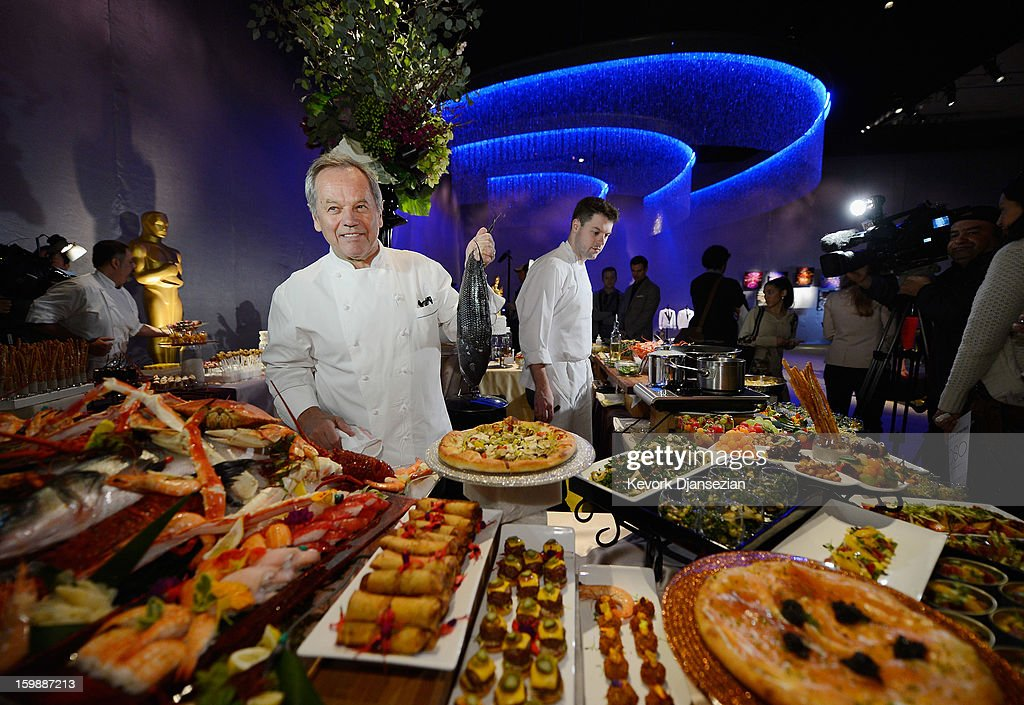 Master chef Wolfgang Puck holds a whole fish during a preview of the Governors Ball on January 22, 2013 in Hollywood, California. Academy governor Jeffrey Kurland, event producer Cheryl Cecchetto and Puck will return to create this year's Governors Ball, the Academy's official post-Oscar celebration, which will immediately follow the 85th Academy Awards ceremony on Sunday, February 24. The 1,500 guests include Academy Award winners and nominees, show presenters and other telecast participants.