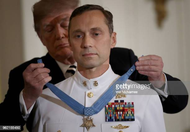 Master Chief Petty Officer Britt K Slabinski is presented with the Medal of Honor by US President Donald Trump May 24 2018 in Washington DC Slabinksi...