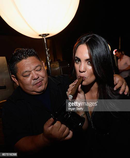 Master cigar roller Luis Mejia of M Cigars lights a newly rolled cigar for guest Angelica Lopez of Las Vegas Nevada during the Las Vegas Food Wine...
