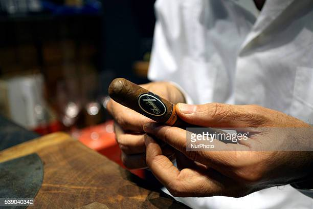 A master cigar rolling expert rolls cigars on behalf of a major tobacco brand in Athens May 19 2016