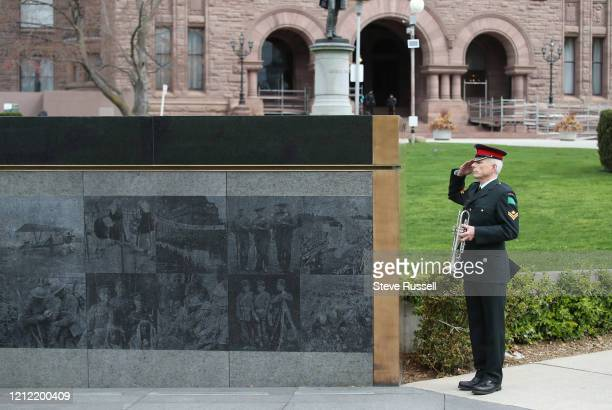 Master Corporal Charles Trimble of the Royal Regiment of Canada salutes during a moment of silence. Premier Doug Ford attends wreath-laying ceremony...