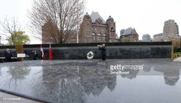 Master Corporal Charles Trimble of the Royal Regiment of Canada plays the last post. Premier Doug Ford attends wreath-laying ceremony to mark the...