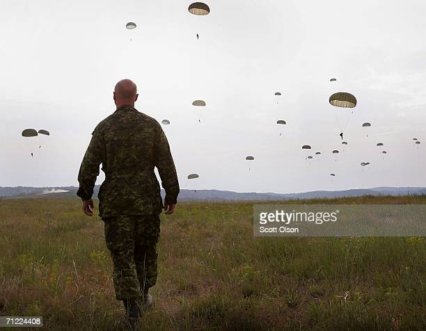Master Corporal Rafael Misiaczyk of the 3rd Battalion of the Royal Canadian Regiment out of Petawawa Ontario Canada watches his fellow soldiers drop...