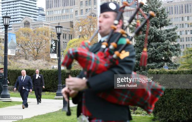 Master Corporal Sean McKenzie-Mardelli of the 48th Highlanders pipes in Premier Doug Ford who attends wreath-laying ceremony to mark the 75th...