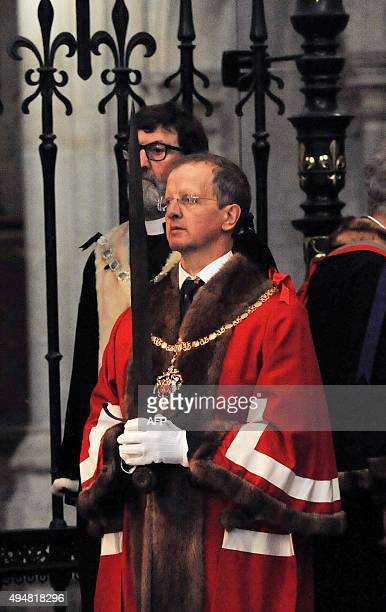 Master Cutler Janek Wichtowski carries the sword of England's King Henry V as it is processed through Westminster Abbey during a service to...