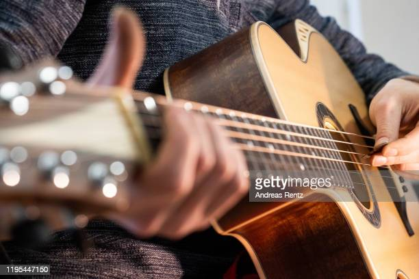 Master guitar craftsman Tobias Ahlke plays the first tones of an acoustic guitar body at his workshop on December 11, 2019 in Remagen, Germany. Ahlke...