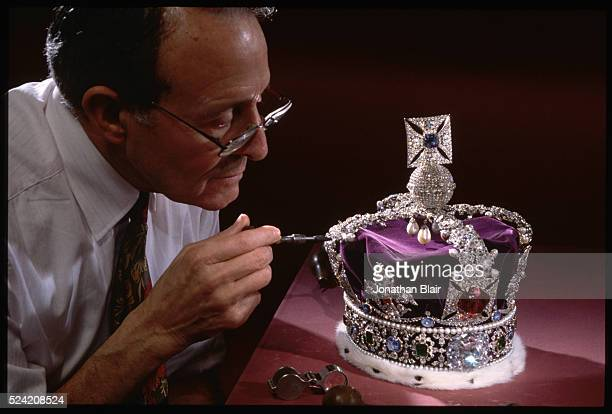 Master Jeweler Henry Phillips has the annual honor of cleaning the real crown jewels Here he polishes the Imperial State Crown's 2800 diamonds...
