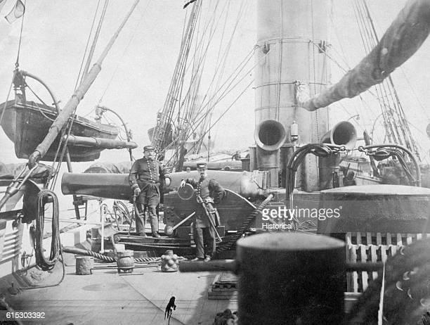 Master JR Wheeler and Engineer SL Smith near an eleveninch pivot gun that sits forward on the USS Kearsarge Captain John A Winslow led the Kearsarge...