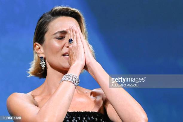 Master of Ceremonies and festival sponsor Italian actress Anna Foglietta reacts during the opening ceremony on the opening day of the 77th Venice...