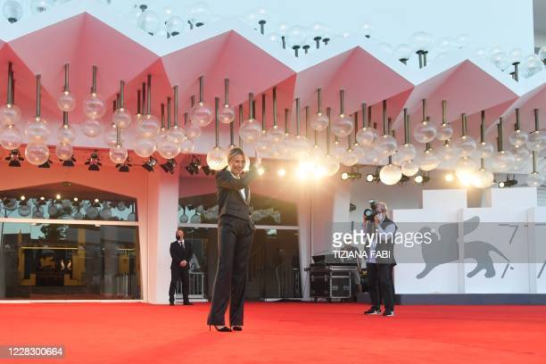 Master of Ceremonies and sponsor of the 77th Venice Film Festival Italian actress Anna Foglietta waves as she poses during a photocall on the red...