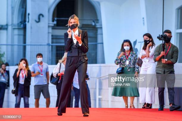 Master of Ceremonies and sponsor of the 77th Venice Film Festival Italian actress Anna Foglietta holds her face mask as she poses during a photocall...
