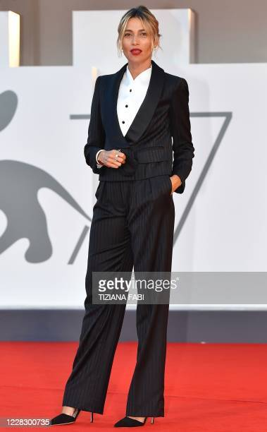 Master of Ceremonies and sponsor of the 77th Venice Film Festival Italian actress Anna Foglietta poses during a photocall on the red carpet outside...