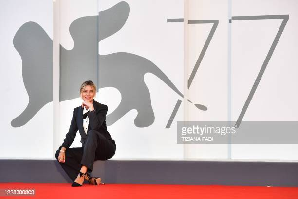 Master of Ceremonies and sponsor of the 77th Venice Film Festival, Italian actress Anna Foglietta poses during a photocall on the red carpet outside...